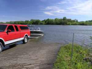 Truck Launching Boat Into Lake