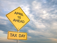 Taxes Day Sign With Sky