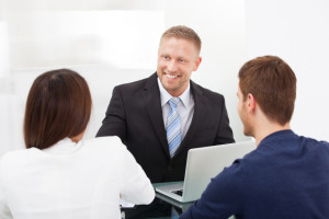 Accountant Discussing With Couple